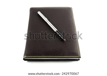 notebook and pen on isolated - stock photo