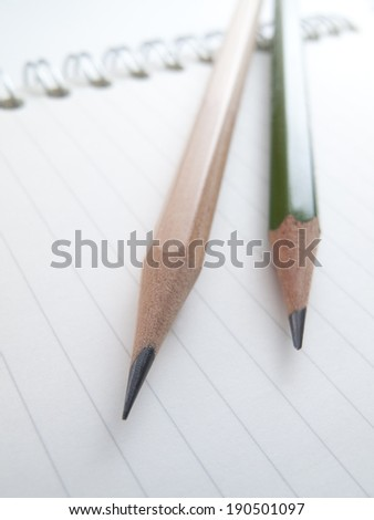 Notebook and pencil - stock photo