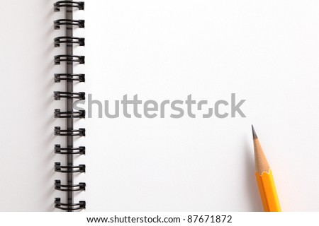 notebook and pencil on white background - stock photo