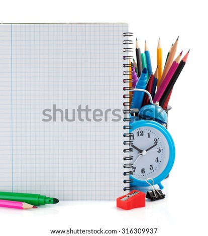 notebook and school supplies isolated on white background - stock photo
