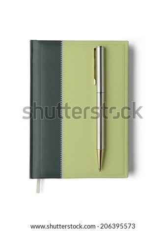 Notebook and silver pen on white background with clipping path. Above view. - stock photo