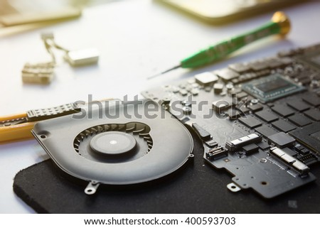 notebook computer on a desk of repair. - stock photo