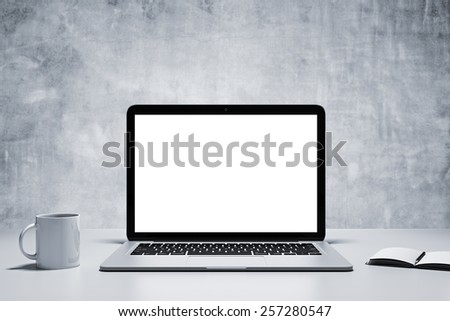 notebook, cup and diary on table in office - stock photo