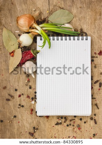 notebook for recipes and spices on an old wooden table - stock photo