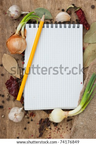 notebook for recipes on the background of spices and table - stock photo