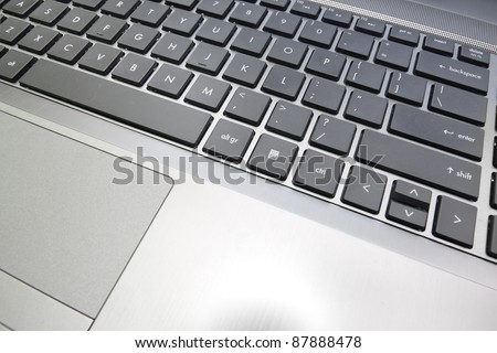 notebook laptop close up on a keyboard - stock photo