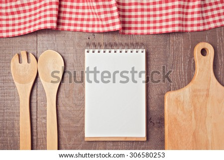 Notebook mock up template with kitchen utensils and tablecloth. View from above - stock photo