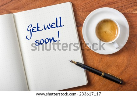 Notebook on a desk - Get well soon - stock photo