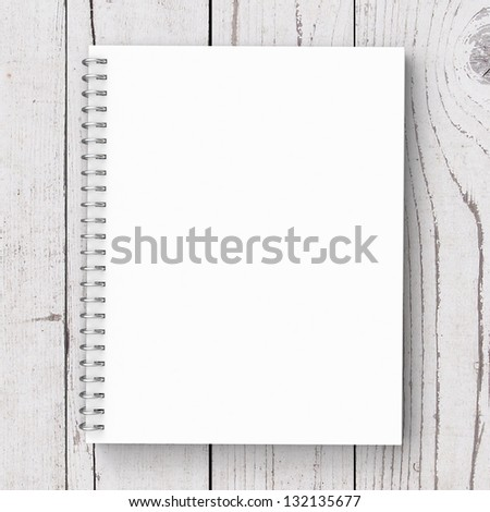 notebook on a wooden background - stock photo