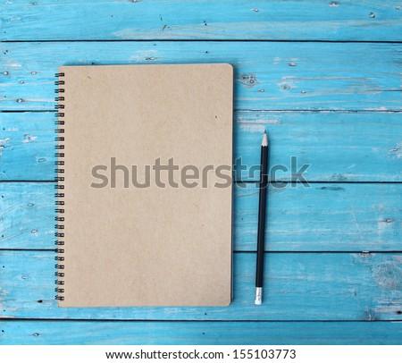 Notebook on desk - stock photo