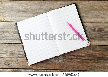 Notebook on grey wooden background - stock photo