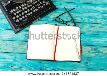 Notebook on the table next to the old typewriter. Clear place for your text entries for advertising information. Template preparation certificate.  Workplace writer journalist blog editor. Top view - stock photo