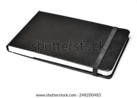 notebook on white background - stock photo