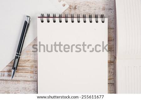 Notebook on wood table for text and background - stock photo
