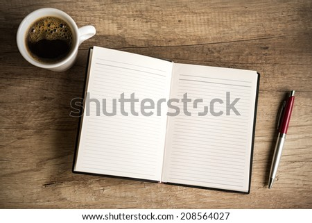 Notebook on wooden table, top view - stock photo
