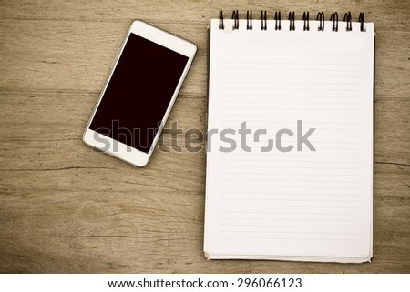 notebook on wooden table top view - stock photo