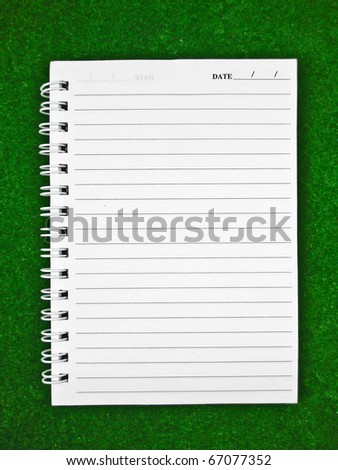 Notebook Paper on green background - stock photo