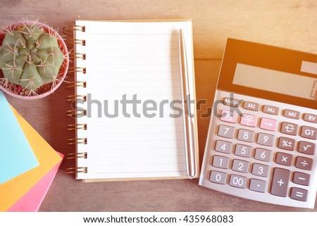 Notebook, pen and calculator. - stock photo