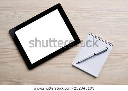 Notebook, pen and digital tablet pc with blank screen on wood table background. Business concept - stock photo