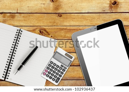 Notebook, pen, calculator and tablet pc, on wood table background. Business concept - stock photo