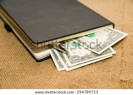 notebook with a blank sheet, pencil and money on the old tissue - stock photo