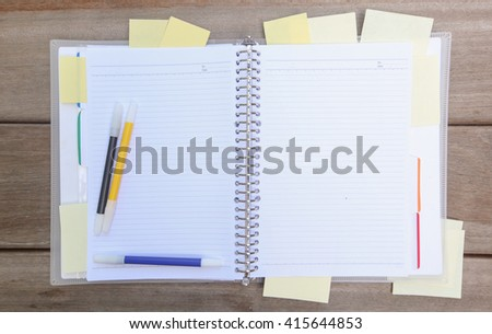 Notebook with colorful  pens and sticky notes with space for text  - stock photo