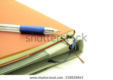 Notebook with Pen On a white background - stock photo