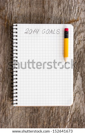 Notebook with pencil and goals of year 2014 - stock photo