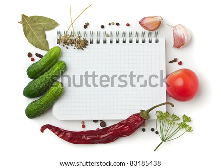 Notebook with recipes and shopping list in the kitchen - stock photo