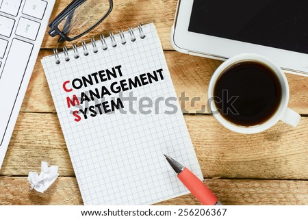Notebook with search engine optimization. Workplace with keyboard , tablet pc , coffee, notebook with search engine optimization and pen on wood table - stock photo