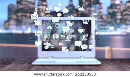 Notebook with social media related icons and blurred night city in the background. Social media concept.  - stock photo