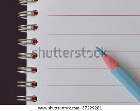 notebook with spiral and blue pencil - stock photo