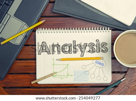 Notebook with text inside Analysis on table with coffee, notebook and pencils  - stock photo