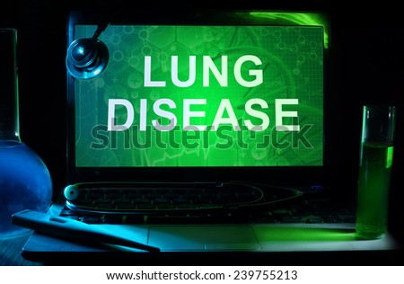 Notebook with words  Lung Disease, test tubes and stethoscope - stock photo