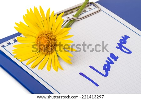 """Notebook with yellow daisies and handwritten """"I Love You"""" - stock photo"""
