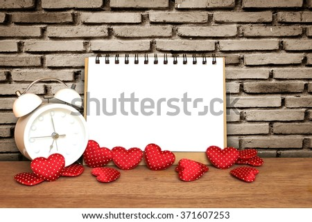 notepad and small heart with old dirty brick wall  - stock photo