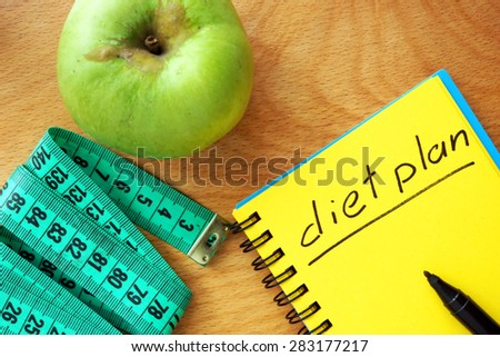 Notepad with words  diet plan on a wood board. Weight lose concept. - stock photo