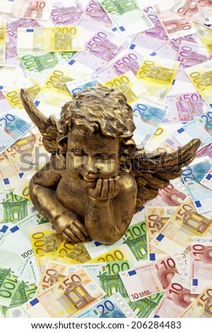 Notes and angel statue - stock photo