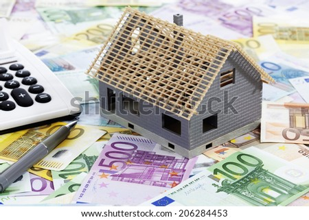 Notes and model house - stock photo