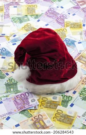 Notes and Santa Claus hat - stock photo