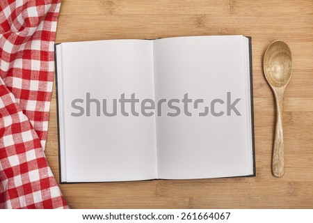 Notes. blank cooking recipe notes or book  with pencil on kitchen table - stock photo