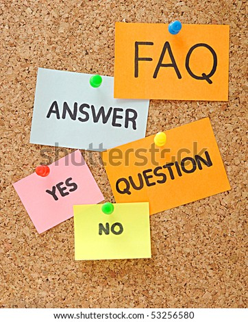 notes with faq over brown cork background - stock photo