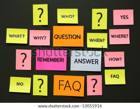 notes with questions and faq over school blue board - stock photo