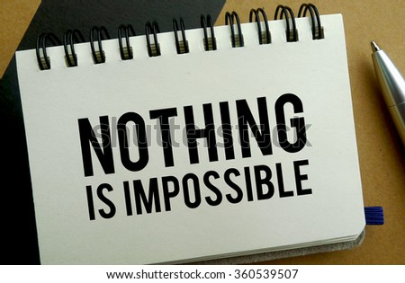 Nothing is impossible memo written on a notebook with pen - stock photo