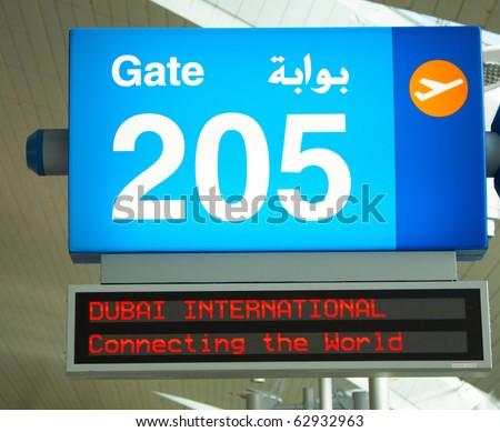 Notice board in Dubai airport - stock photo