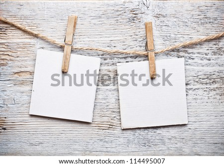 Notice card, white paper and wood clip - stock photo