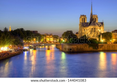 Notre Dame cathedral and seine river in Paris, France. - stock photo