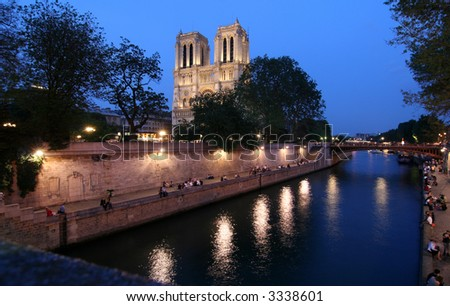 Notre Dame cathedral in Paris at night - stock photo