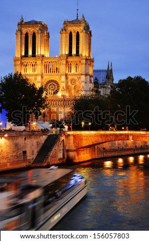 Notre-Dame Cathedral in Paris, France after sunset - stock photo