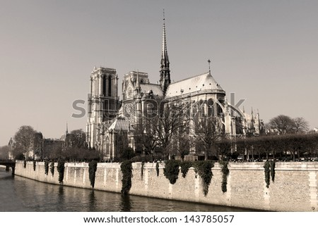 Notre Dame cathedral in the center of Paris, France (sepia image) - stock photo